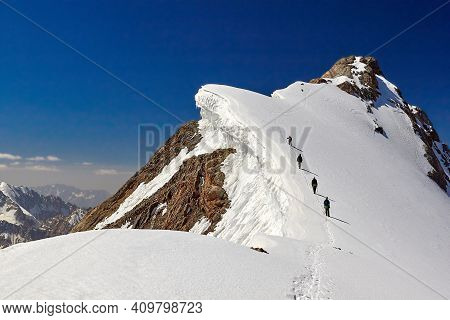 Bunch Of Mountaineers Climbs To The Top Of Snow Capped Mountain, Fann, Pamir Alay,