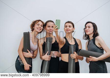 Smiling Friendly Women Socialising At Yoga Club, Taking Selfie