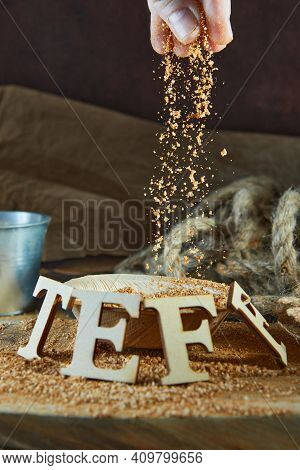 Teff, An Alternative To Ancient Gluten-free Grain With The Name Written In Wooden Letters. Teff Pour