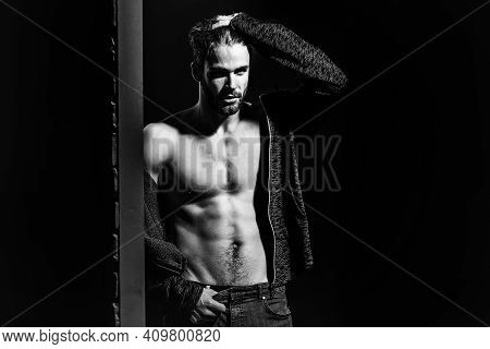 Sexy Man With Muscular Bare Torso In Studio On Black And Brick Wall Background, Copy Space