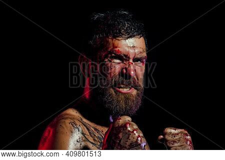 Angry Man With Blood Paint On Angry Face. Hipster In Fight Position With Fists On Black Background.