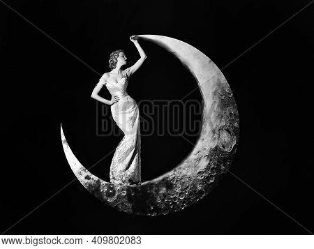 Young Woman In Evening Elegant Dress. Fashion Night Dress. Beautiful Young Women Posing On Crescent