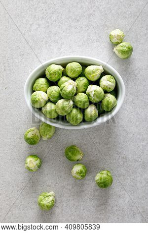 Fresh Green Brussels Sprouts On Cooking Kitchen Table. Top View