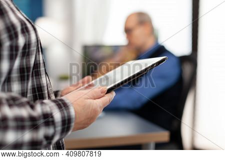 Senior Woman Holding Tablet Pc Standing Up. Close Up Of Elderly Woman Using Moder Technoloy Tablet P