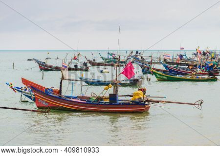 Koh Samui, Thailand - January 2, 2020: Long Tail Fishing Boats Docked Near Thong Krut Beach On A Day