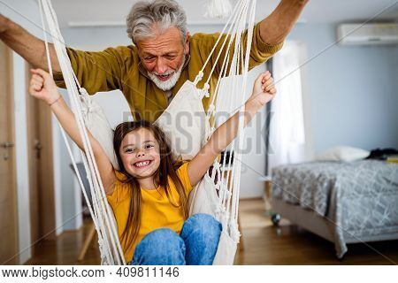 Happy Grandparent Having Fun Times With Kid At Home