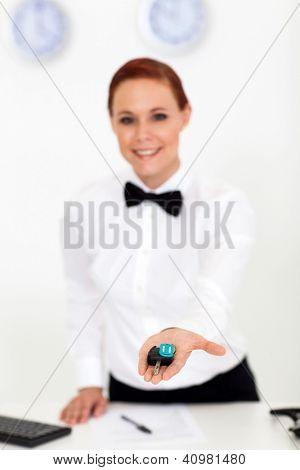 car rental company employee giving car key to customer