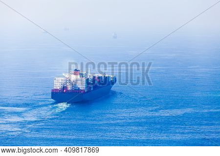 Container Ship Goes On Red Sea, Rear View. Saudi Arabia