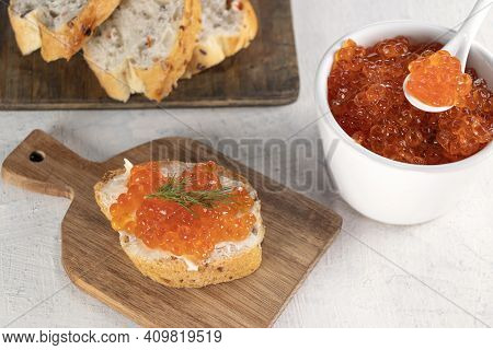Baguette, Red Caviar, Dill On White Background. Cooking Process. Recipe For Making An Appetizer With
