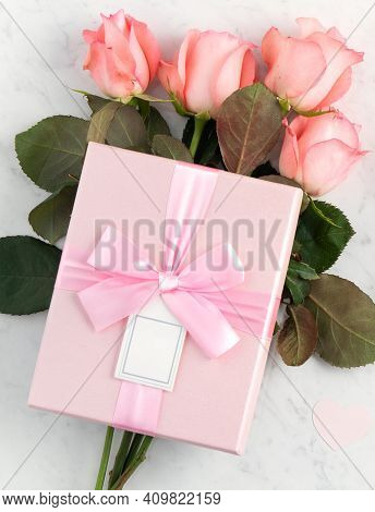 Giftbox And Pink Rose For Mother's Day Holiday Greeting Design Concept.