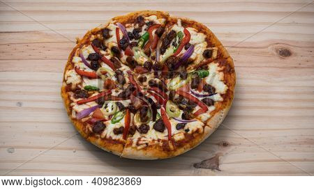 Delicious Devilled Chicken Pizza On A Wooden Surface Overhead Top View Close-up Photograph. Mozzarel