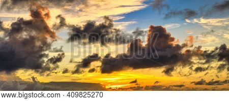 Seychelles Dramatic Sky With Dark Clouds At Sunset, Nature Background In Summer With Moving Clouds.