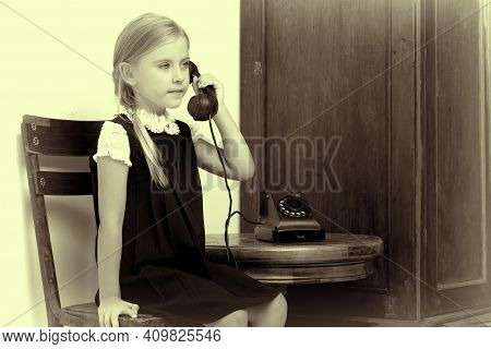 Cute Girl Speaking Via Vintage Phone. Lovely Blonde Girl Talking On Old Fashioned Dial Phone In Stud