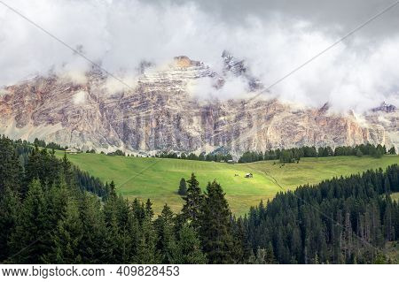 Picturesque Alpine Meadow At The Foot Of The Dolomites Covered With Clouds. Trentino, Alto Adige, It