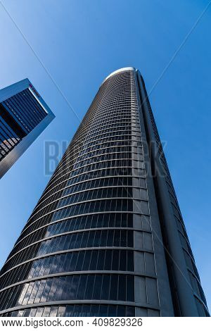 Madrid, Spain - February 7, 2021: Low Angle View Of Skyscrapers In Cuatro Torres Financial District.