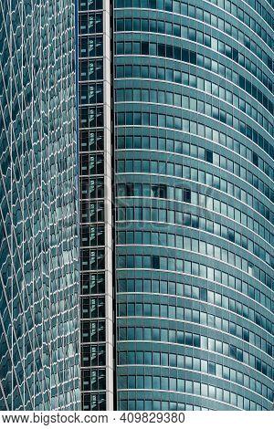 Madrid, Spain - February 7, 2021: Full Frame Of Glass Facade Of Skyscraper In Cuatro Torres Financia