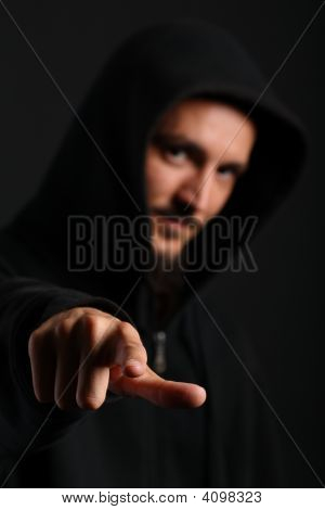 Young Man Points His Finger Towards The Camera