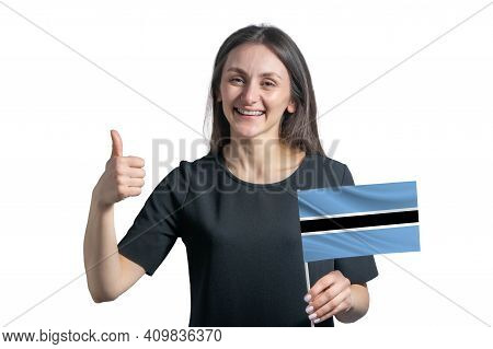 Happy Young White Woman Holding Flag Of Botswana And Shows The Class By Hand Isolated On A White Bac