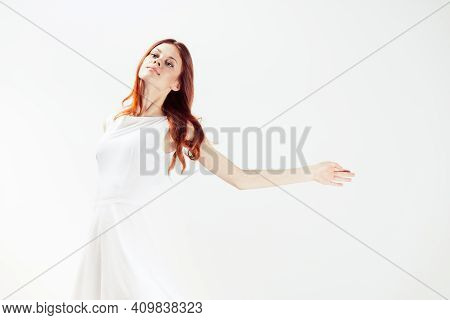 Pretty Woman In White Dress Glamor Red Hair Light Background