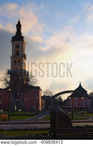 Scenic Sunset Landscape View Of Old City Hall 14-16th Centuries. Former House Of The Polish Magistra