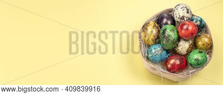 Banner With Colorful Eggs In The Nest. Eggs In Nest. Happy Easter Concept. Painted Eggs In A Nest Wi