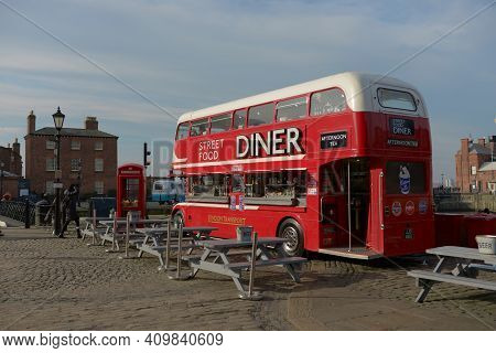 Liverpool, United Kingdom, 2nd February, 2020: Spring Time Sunshine Lights The Big Red Double Decker
