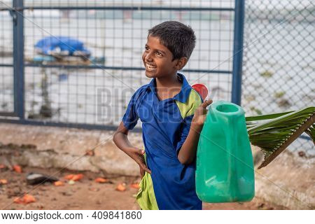 Varanasi. India. 10-02-2018. Portrait Of A Happy Kid At School While Fetching Water.