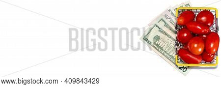 Tomatoes In Shopping Basket Isolated On White Background With Various Us Dollar Bills Underneath It.