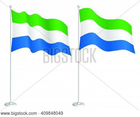 Flag Of Republic Of Sierra Leone On Flagpole Waving In Wind. Holiday Design Element. Checkpoint For
