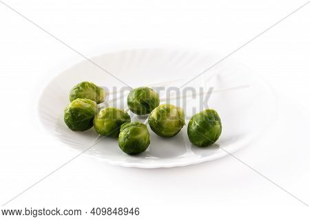 Set Of Brussel Sprouts With Lollipop Sticks On White Background