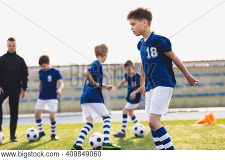 Football Education For Kids. Physical Education For Children. Young Coach With Kids In Soccer Team O