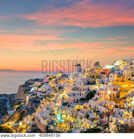 Sunset night view of Famous Greek village Oia on Santorini island in Greece. Santorini is iconic travel destination in Greece, famous of its sunsets and traditional white architecture