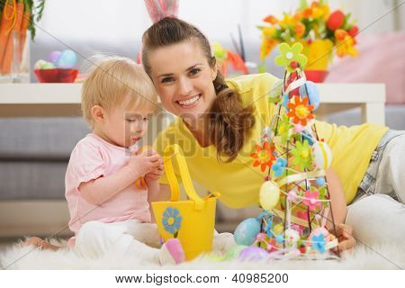 Baby and mother spending time together on Easter poster