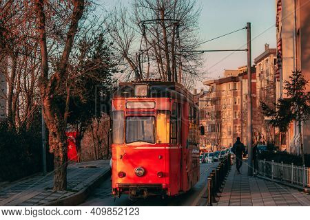 Old Nostalgic Tram Going Through The Streets Of Kadikoy On The Asian Side Of Istanbul. Sunset View.