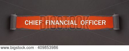 Chief Financial Officer - Text On Red Background Appears Behind Torn Paper