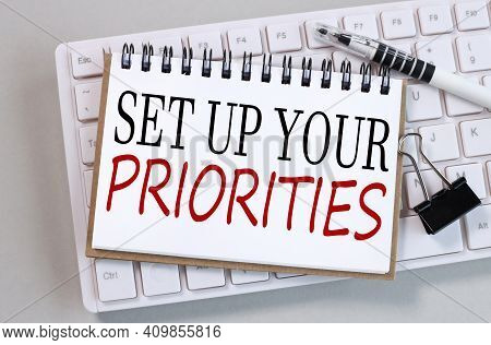 Set Up Your Priorities. Text On White Notepad Paper On White Keyboard On Gray Background