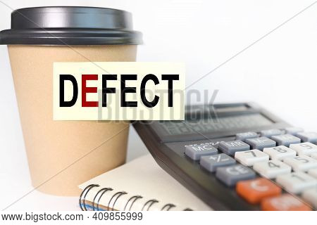Defect. Text On Yellow Sticker. Sticker Pasted On A Cup Of Coffee On A White Background. Business Co