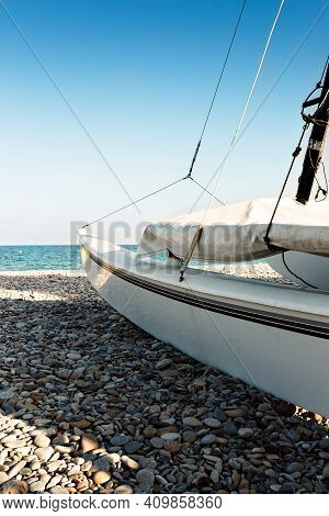 Catamaran On The Beach On The Stones. Vertical Image.