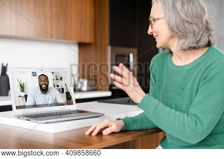 Senior Online Tutor, Trainer, Coworker Is Talking Via Video Connection With An African Man On The La