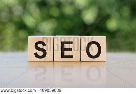 Seo - Search Engine Optimisation, Word Written On Wooden Blocks. The Text Is Written In Black Letter