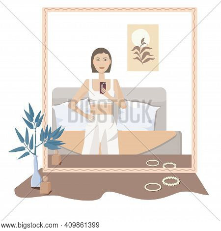 A Young Brunette Woman In Great Mood With Short Hair And Pajamas Looks In The Mirror And Takes A Sel