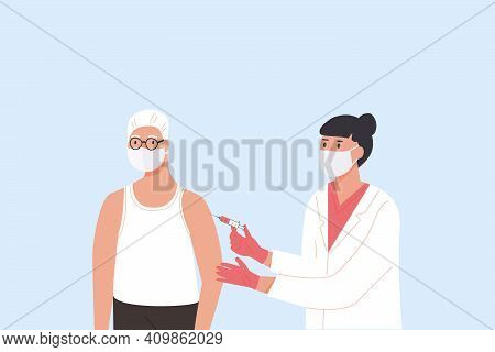 Female Doctor In Medical Gown And Gloves Gives Vaccine Shot To Elder Male Patient. Vaccination Campa