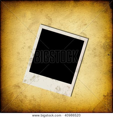 Blank Instant Photo Frame On Old Grunge Paper Background