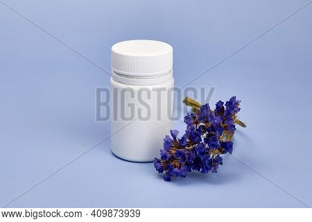 Dried Flower Near A Jar Of Pills, Herbal Medicines, Homeopathic Concept.