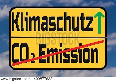Traffic Sign With The German Words For Climate Protection And Co2 Emissions. With Sky In The Backgro
