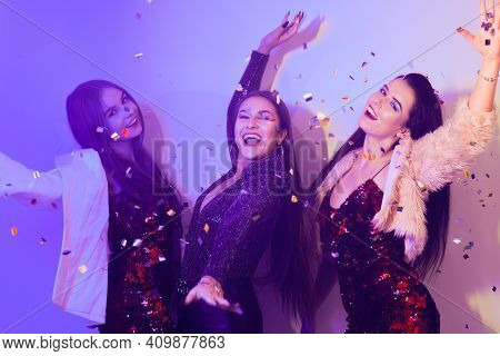 Three Beautiful Girls Are Dancing In Neon. An Incredibly Fun Party With Girls In Shiny Dresses, They