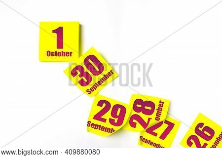 October 1st . Day 1 Of Month, Calendar Date. Many Yellow Sheet Of The Calendar. Autumn Month, Day Of