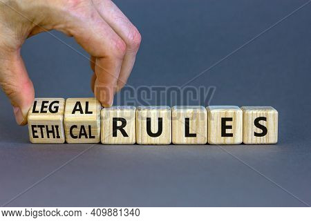 Ethical Or Legal Rules Symbol. Businessman Turns Wooden Cubes And Changes Words 'ethical Rules' To '