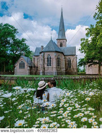 Castle De Haar Utrecht, Couple Men And Woman Mid Age European And Asian Visit De Haar Castle In Dutc