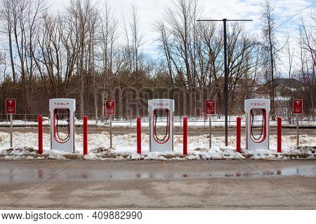 Collingwood, Ontario, Canada - 02-23-2021: Brand New Tesla Ev Electric Car Charging Supercharger Sta